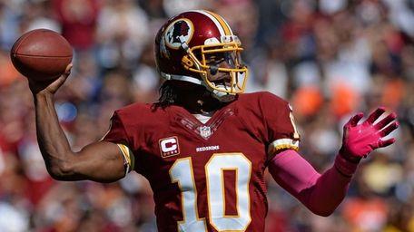 Washington Redskins quarterback Robert Griffin III passes during