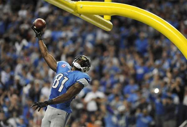 Detroit Lions wide receiver Calvin Johnson celebrates his