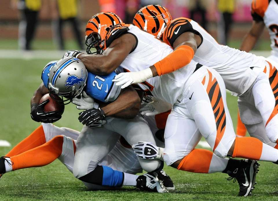 Detroit Lions running back Reggie Bush is stopped