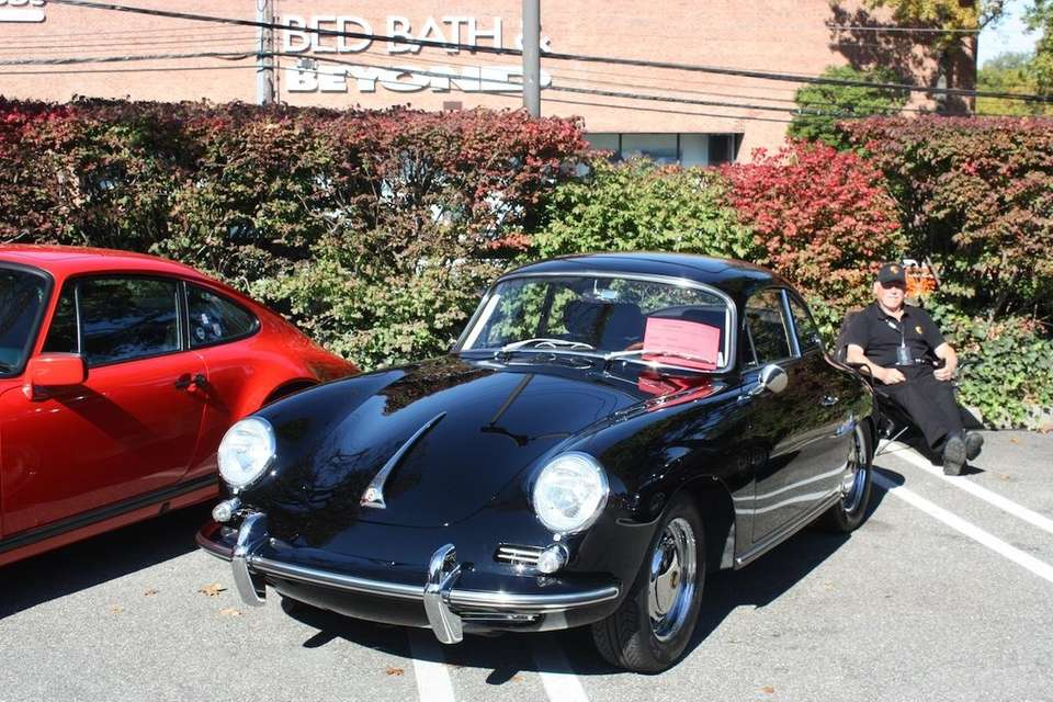 A 1964 Porsche 356 Sunroof Coupe owned by