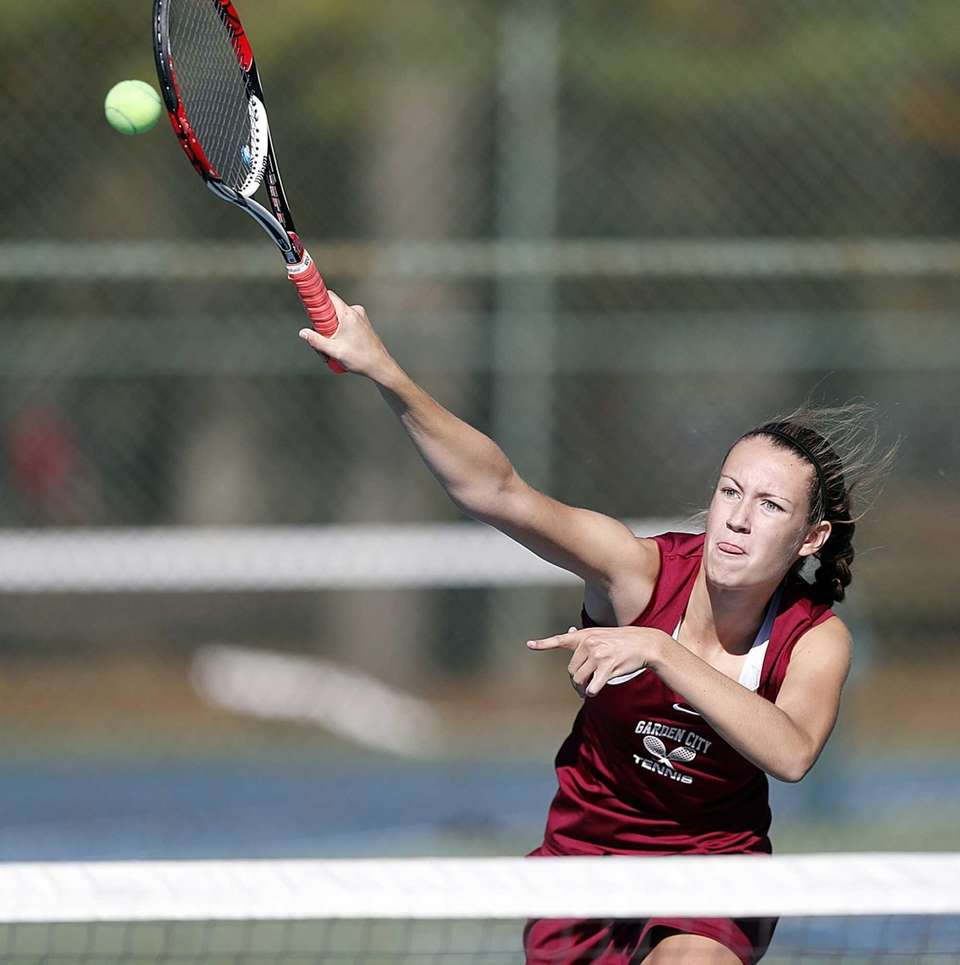 Garden City's Brittney Burke hits an overhead smash