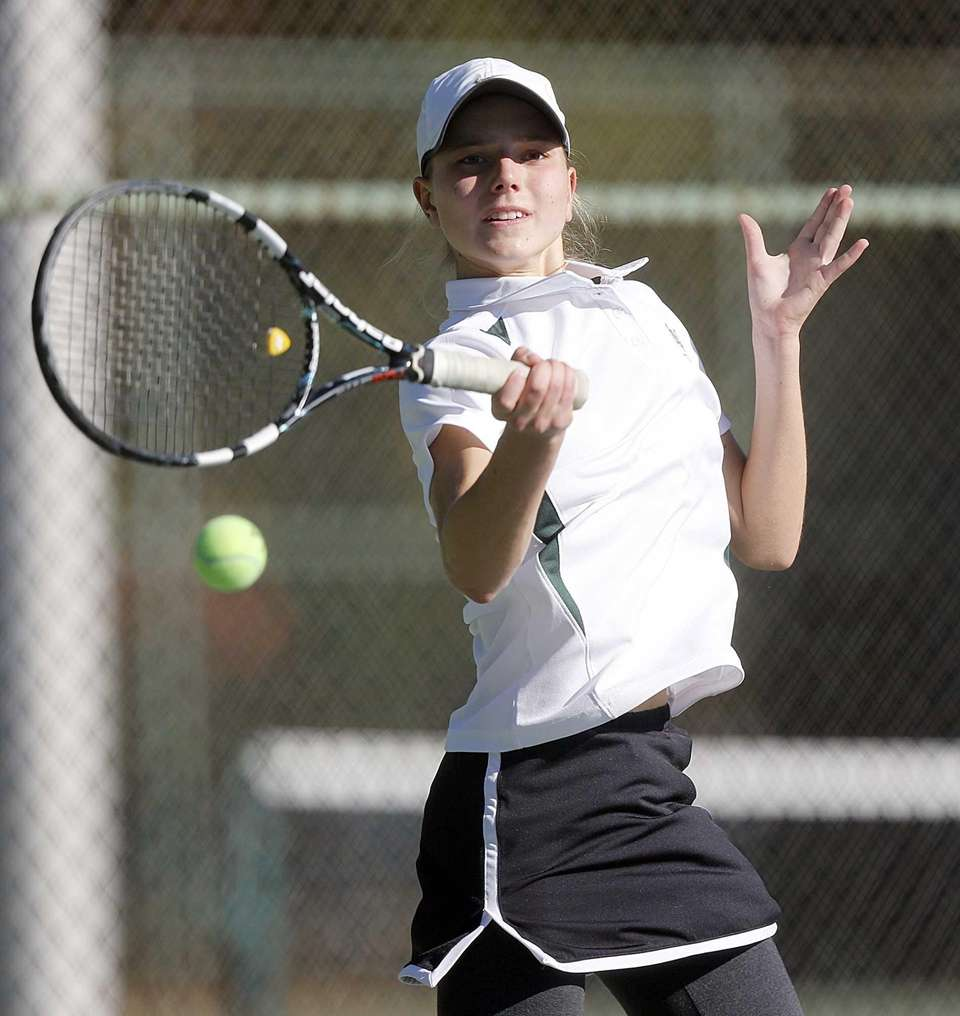 Locust Valley's Alex Koniaev hits a forehand return