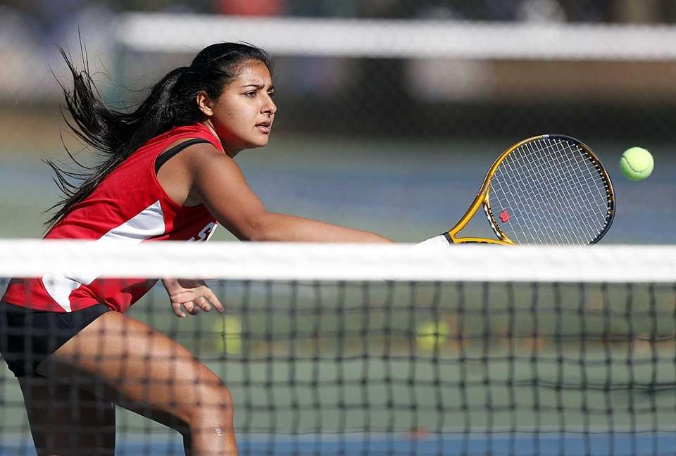 Syosset's Rhea Malhotra hits a backhand volley at