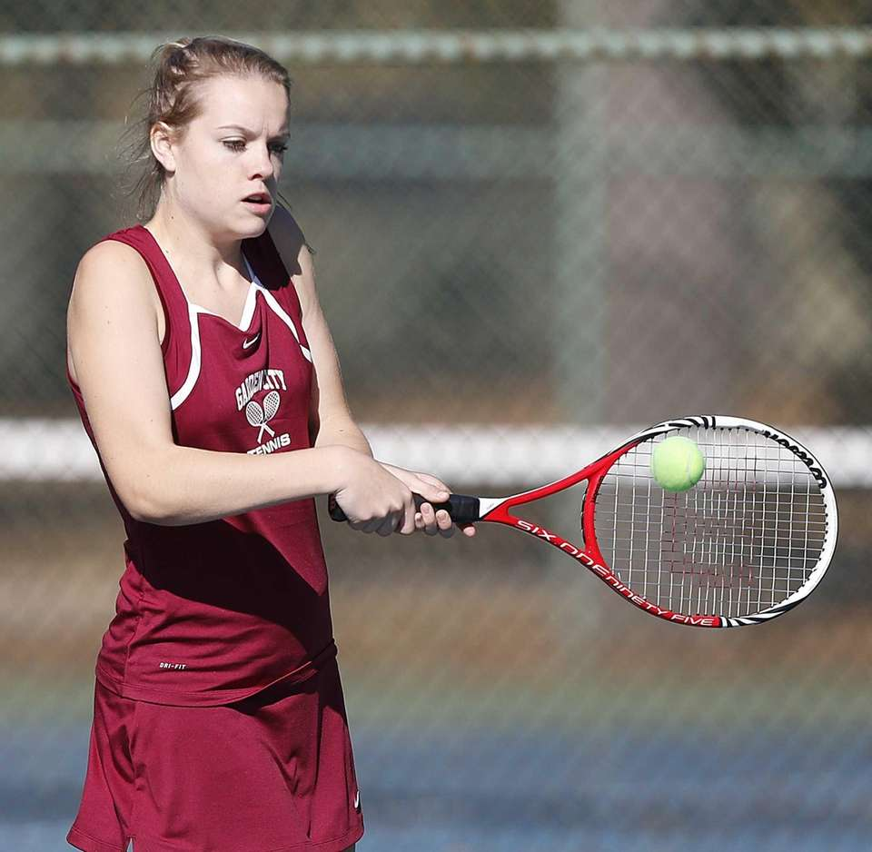 Garden City's Hannah Eilbeck hits a backhand return