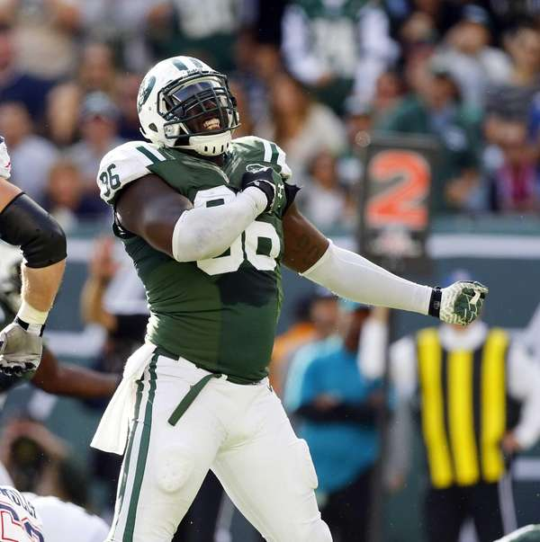 Muhammad Wilkerson reacts after a defensive stop against