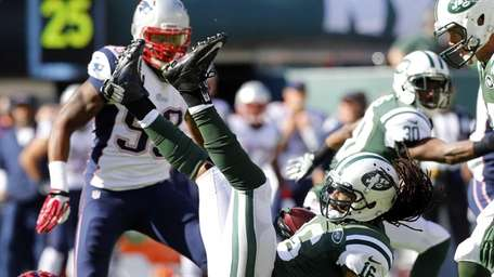 Josh Cribbs is tripped up against the New