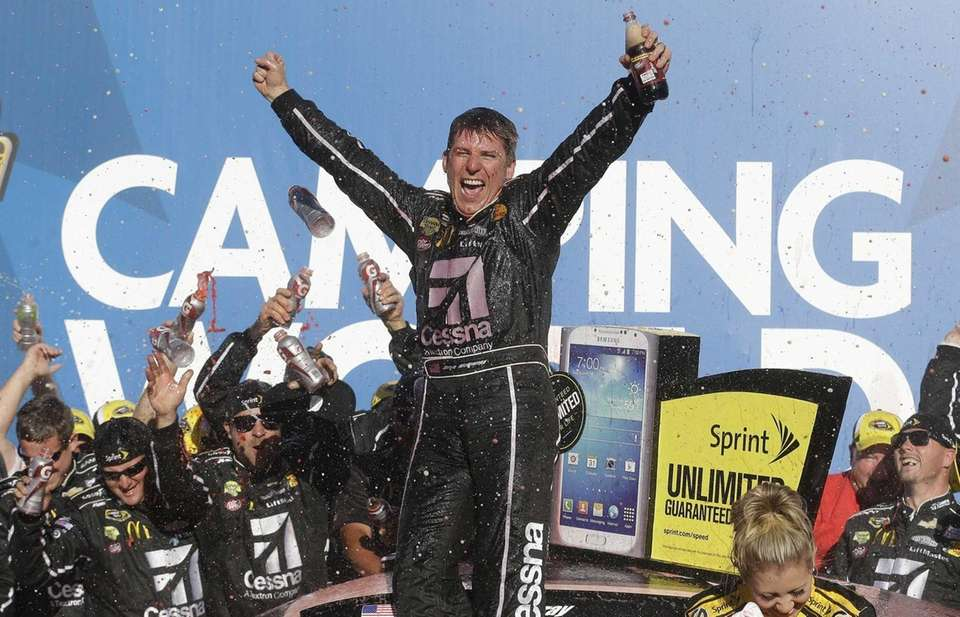 Sprint Cup series driver Jamie McMurray celebrates after