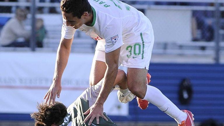 Cosmos midfielder Paulo Mendes collides with FC Edmonton