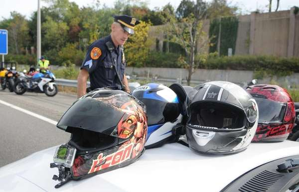 Suffolk County Highway Patrol Sgt. George Hodge inspects