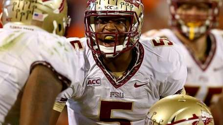 Florida State quarterback Jameis Winston (no. 5) yells
