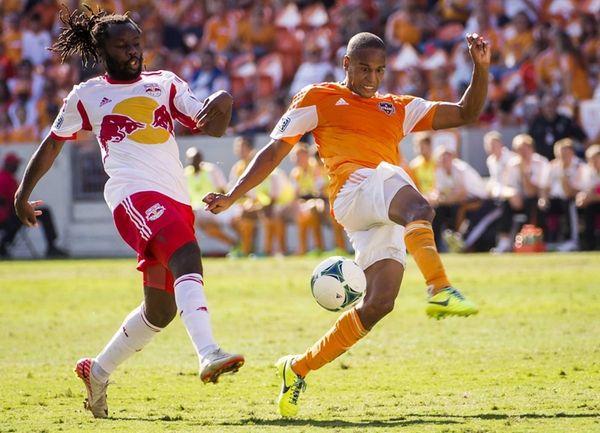 Houston Dynamo midfielder Ricardo Clark, right, fights for