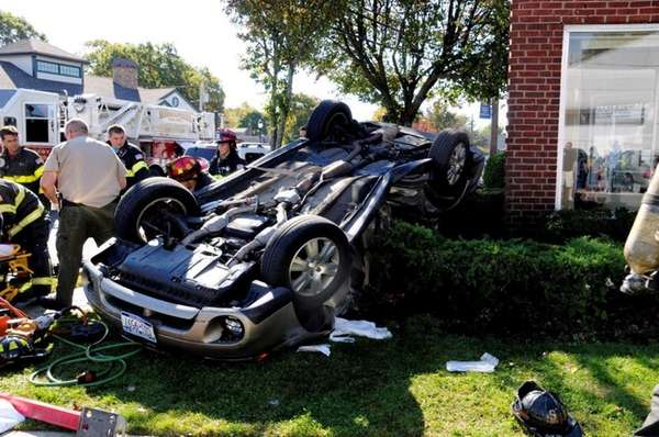 A woman who overturned her car in an