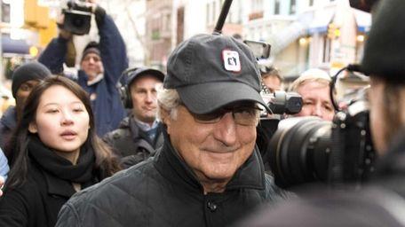 Bernard Madoff walks along Lexington Avenue to his