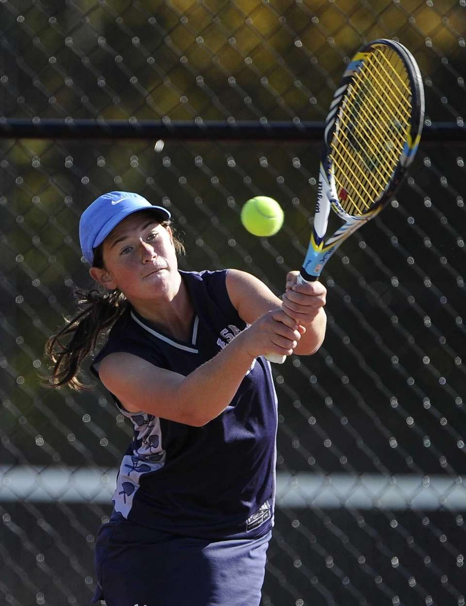 Eastport-South Manor's Jackie Bukzin returns the ball to