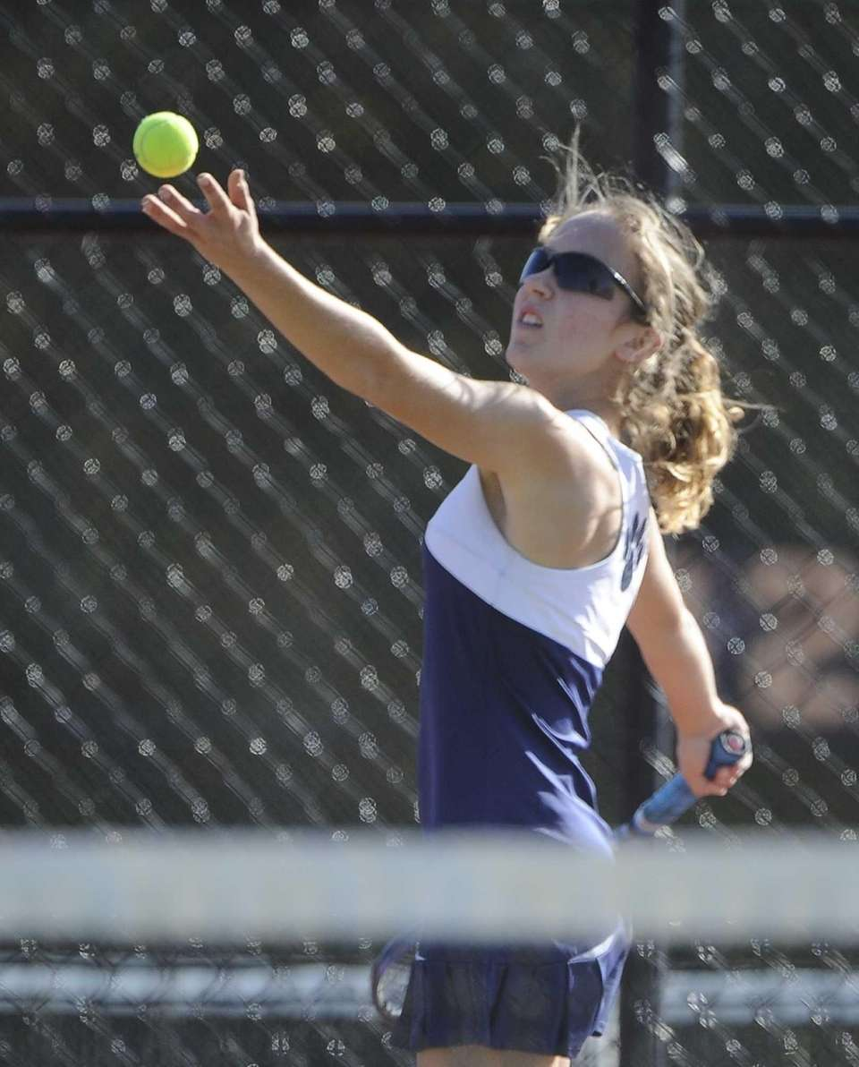 Shoreham-Wading River's Aimee Manfredo serves to Eastport-South Manor's