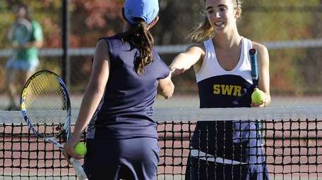 Shoreham-Wading River's Aimee Manfredo shakes hands with Eastport-South