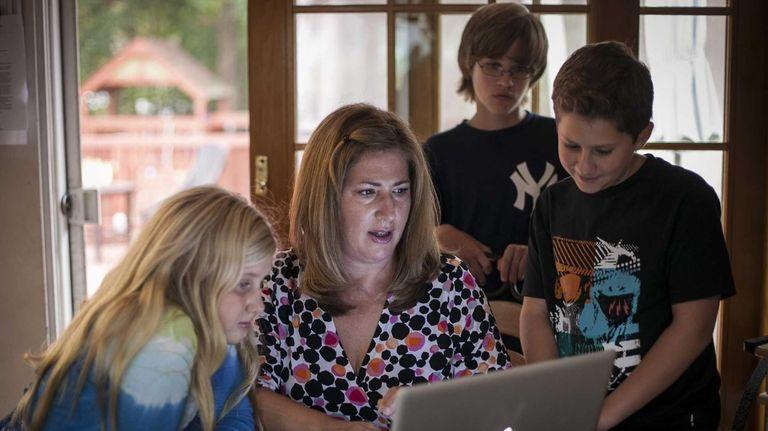 (L-R) Pamela Verity with her children Skylar, 10,