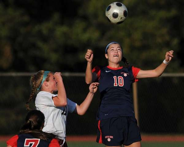 South Side's Juliana Pellegrini, right, goes up for