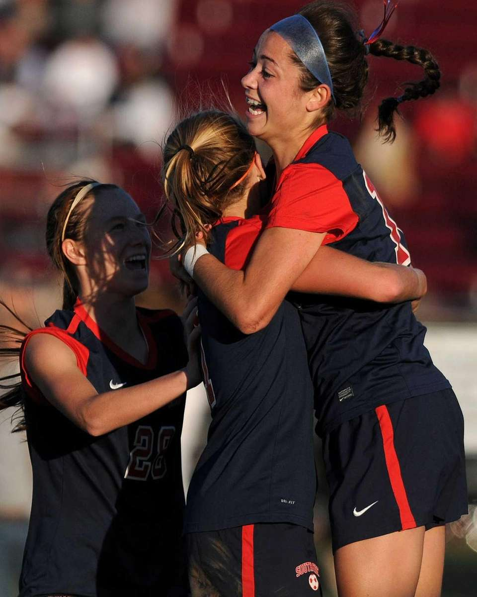 South Side's Juliana Pellegrini, right, gets congratulated by