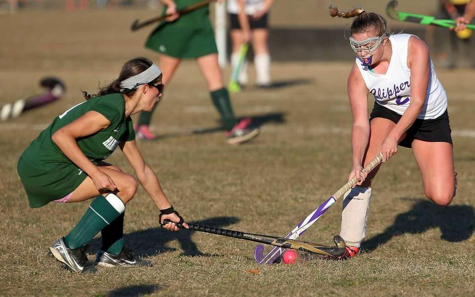 Greenport's Victoria Hilton takes the ball away from