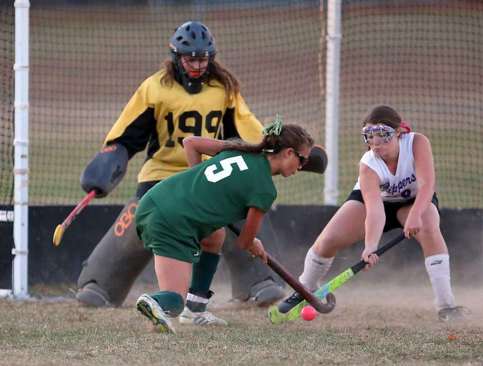 Greenport goalie Brandi Gonzalez watches as Harborfields' Samantha