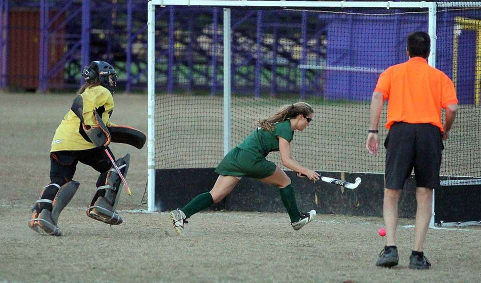 Harborfields' Claudia Maimone moves past Greenport/Southold goalkeeper Brandi