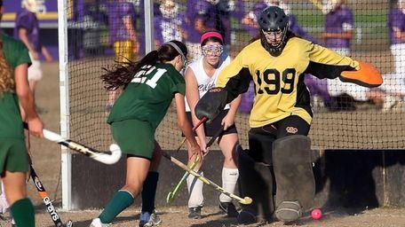 Greenport goalie Brandi Gonzalez makes the point-blank save