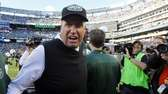 Rex Ryan celebrates on the field after defeating