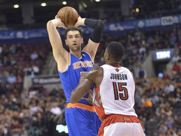 Andrea Bargnani passes the ball over the Toronto