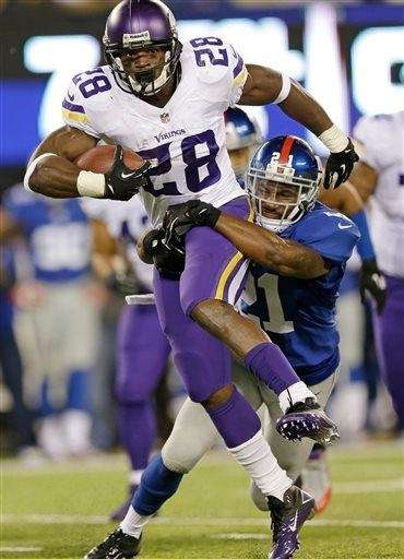 Minnesota Vikings running back Adrian Peterson (28) is