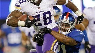Minnesota Vikings running back Adrian Peterson (28) is