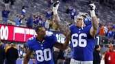 David Diehl and Victor Cruz celebrate after defeating