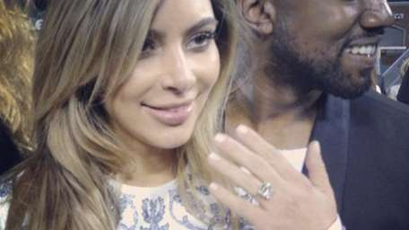 Kim Kardashian and Kanye West after he proposed