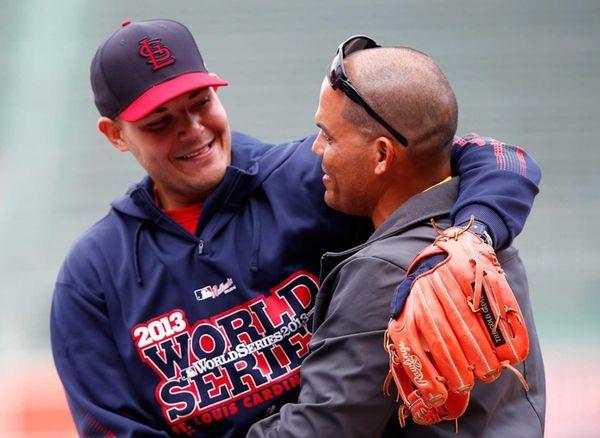 St. Louis Cardinals catcher Yadier Molina hugs former