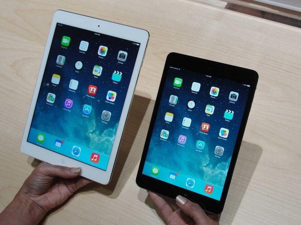 Apple's new iPad Air, left, and iPad Mini