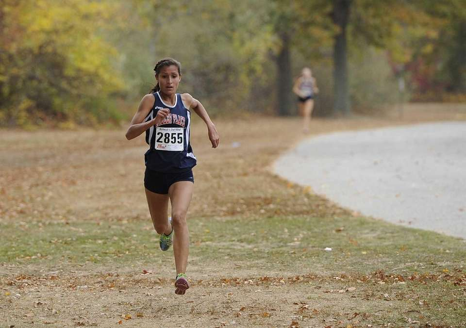 Tiana Guevara runs toward the finish line in
