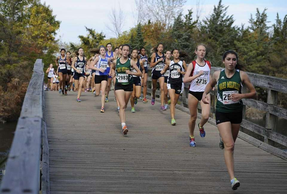 Runners cross a bridge during the Suffolk girls