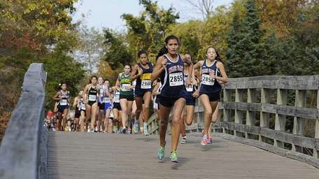 Miller Place's Tiana Guevara leads the runners across