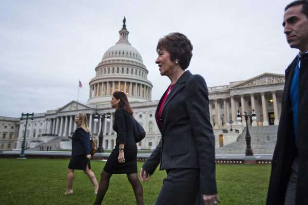 Republican Sen. Susan Collins (R-Maine), foreground, walks across