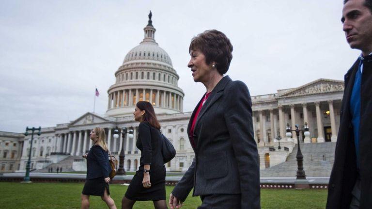 Republican Sen. Susan Collins (R-Maine), foreground, walks across