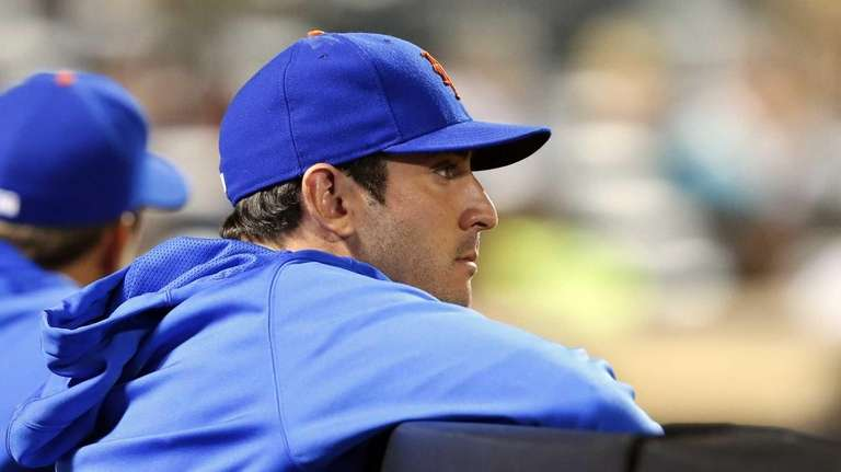 Matt Harvey looks on from the dugout during