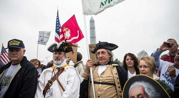 Tea Party activists and Republicans rally at the