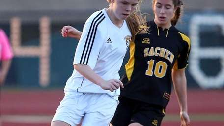 Commack's Erin Neville moves the ball to the