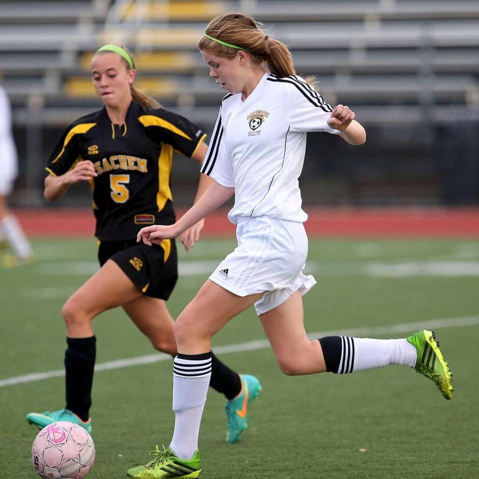 Commack's Erin Neville moves past Sachem North's Alexa