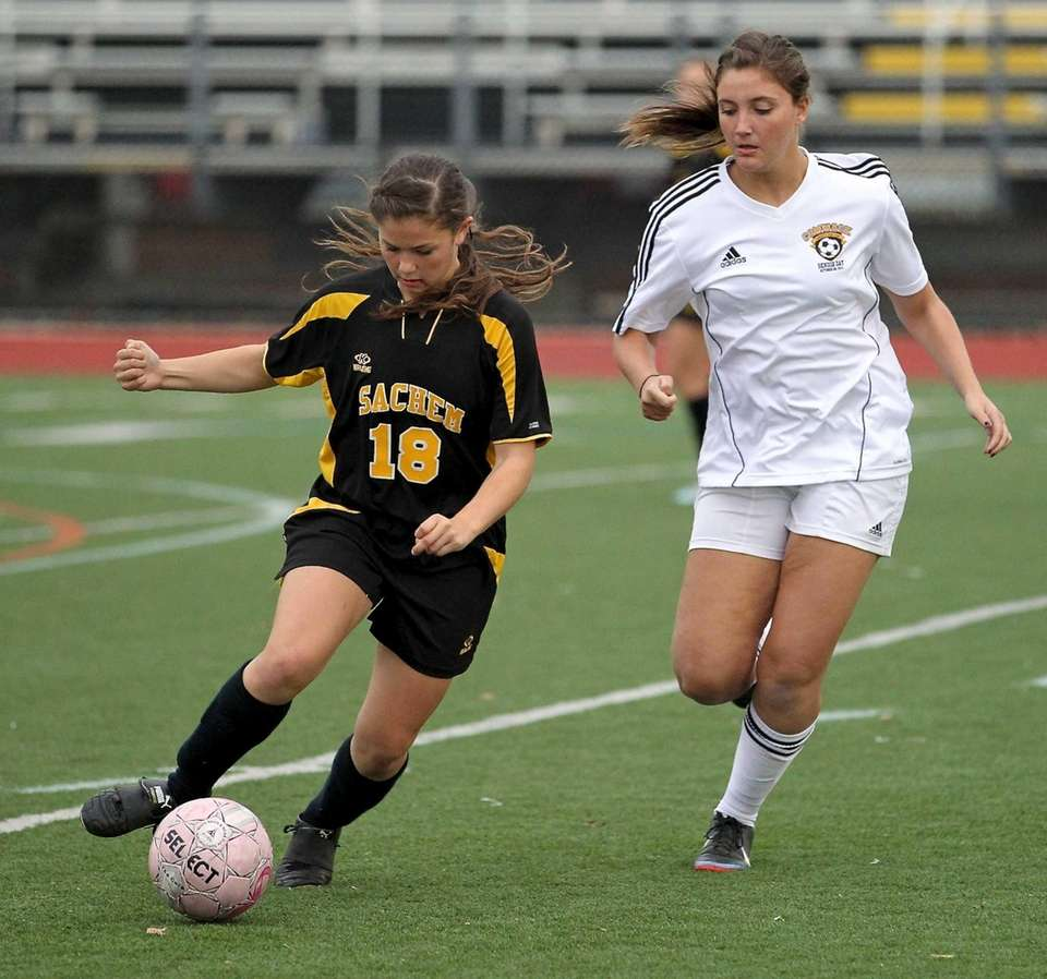 Sachem North's Rachel Loyst moves the ball as