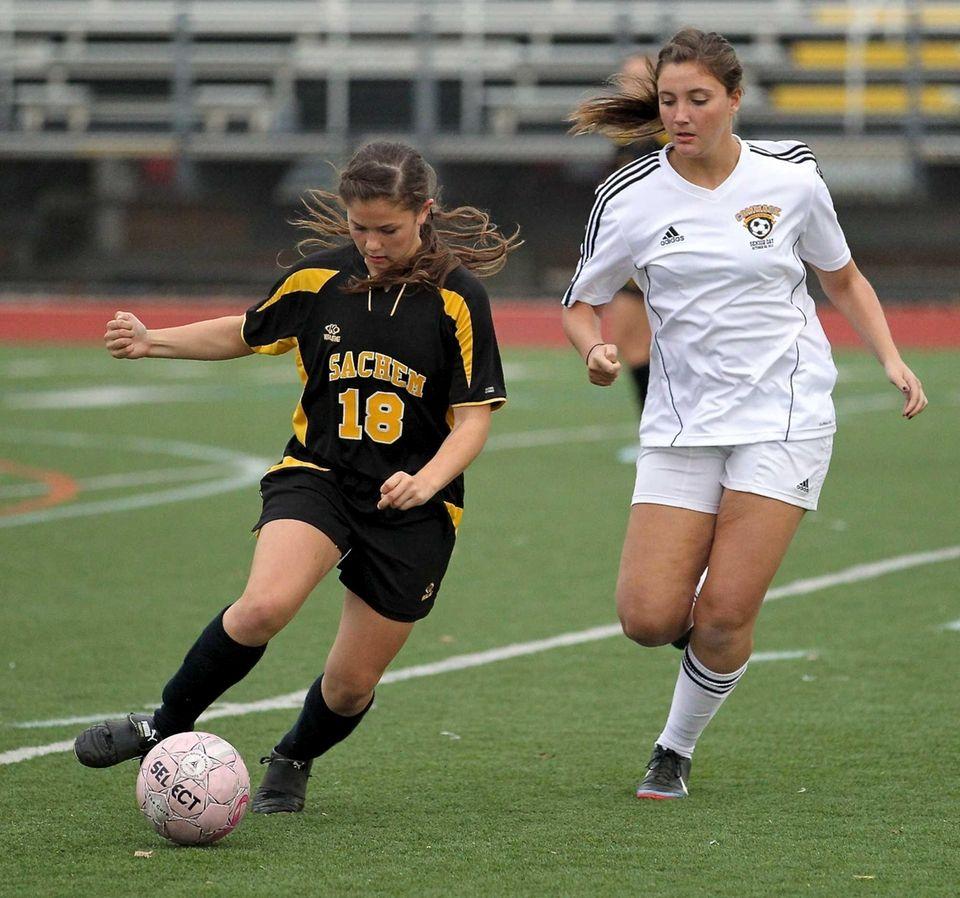 Sachem North's Rachel Loyst moves the ball as