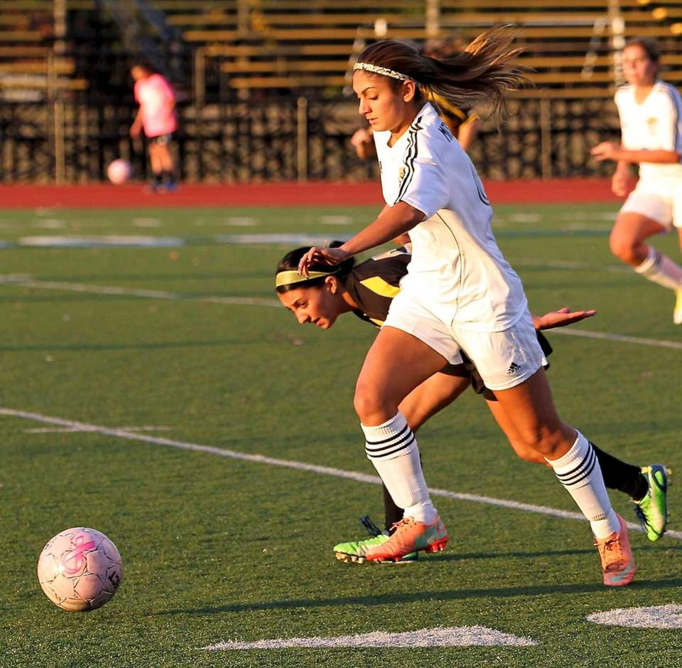 Commack's Julia Montella blows past the Sachem North
