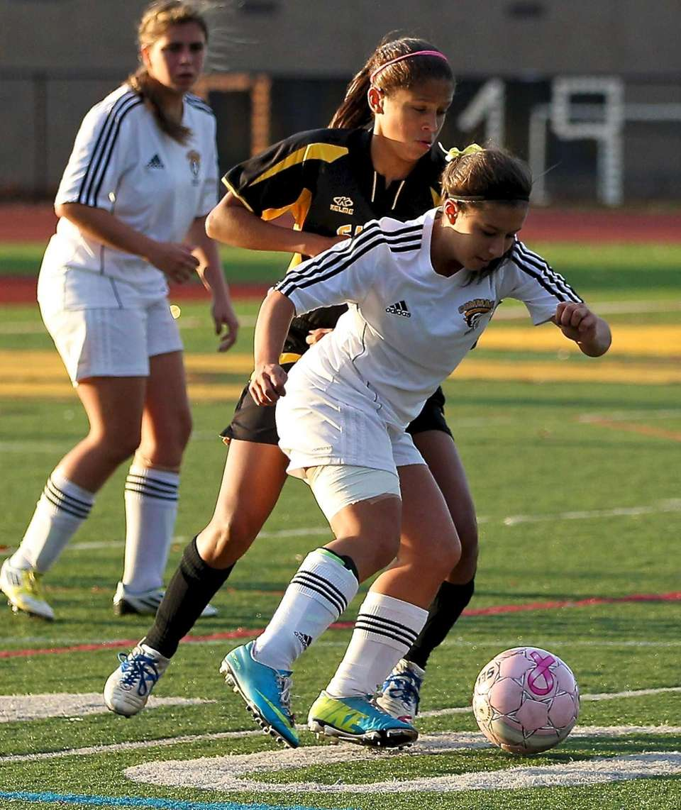 Commack's Erica Fischer looks to get by the