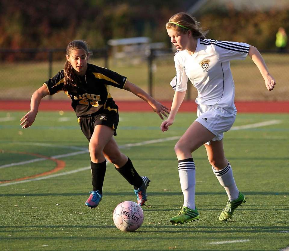 Commack's Erin Neville takes the ball deep into