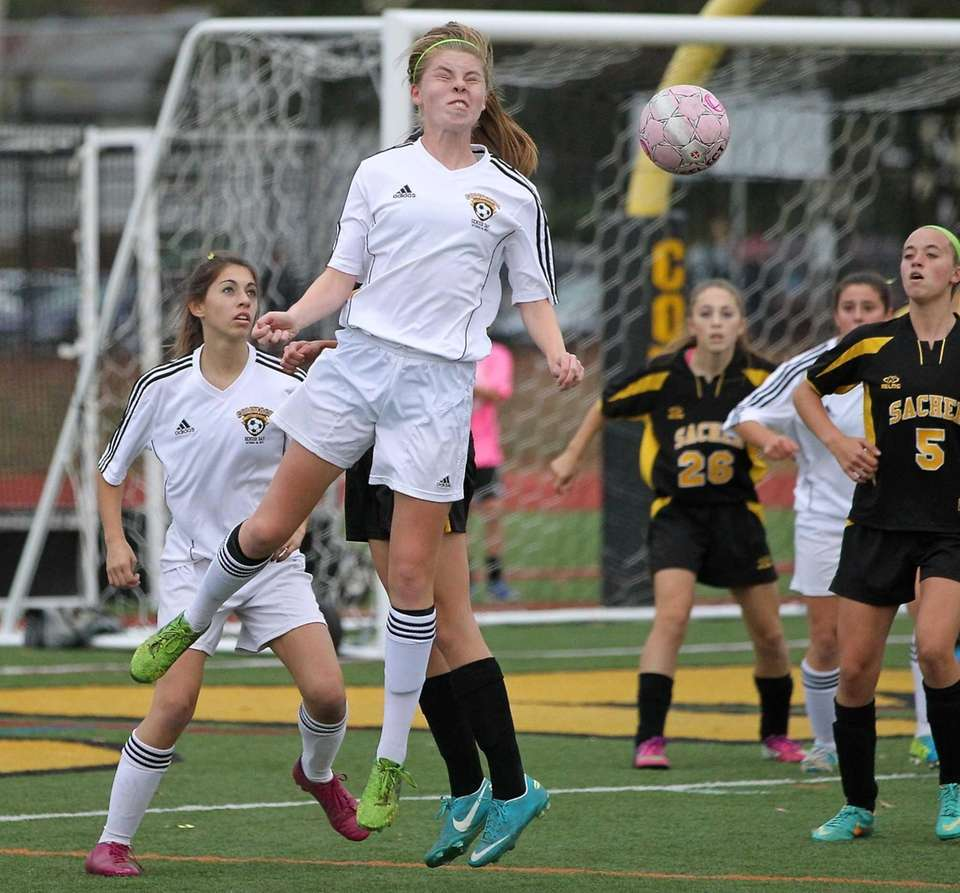 Commack's Erin Neville heads the ball towards the